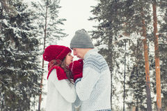 Happy Young Couple in love embracing in Winter Park face to face close to each other Royalty Free Stock Photos