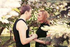 Happy young couple in love in a garden Stock Image