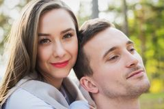 Happy young couple in love hugging. Park outdoors date. Loving couple looking at camera Royalty Free Stock Photo