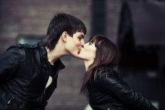 Happy young couple in love kissing on a city street Royalty Free Stock Photo