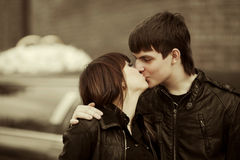 Happy young couple in love kissing on city street Royalty Free Stock Photography