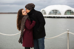 Happy young couple in love kissing outdoor Royalty Free Stock Photos