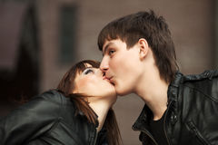 Happy young couple in love kissing outdoor Royalty Free Stock Photography
