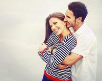 Happy young couple in love at the lake outdoor on vacation, harm stock photography