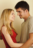 Happy young couple in love, looking at each other Stock Image