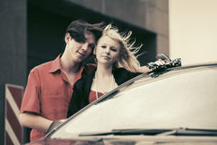 Happy young couple in love with new car Stock Image