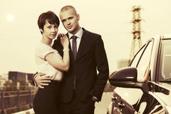 Happy young couple in love next to car. Outdoor Stock Image