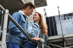 Happy young couple in love outdoors stock image