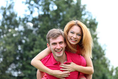 Happy young couple in love at the park Stock Photography