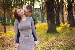Happy young couple in love at the park. Happy young couple in love at the park happy Royalty Free Stock Photography