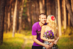Happy young couple in love at the park. Stock Images