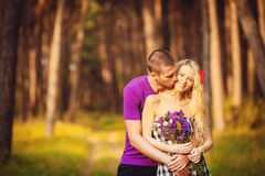 Happy young couple in love at the park. Royalty Free Stock Photo