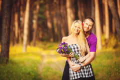 Happy young couple in love at the park. Royalty Free Stock Image
