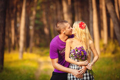 Happy young couple in love at the park. Royalty Free Stock Photos