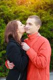 Happy young couple in love at the park. Happy young couple in love hug at the park Stock Image
