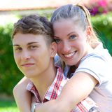 Happy young couple in love playing in park looking Royalty Free Stock Image