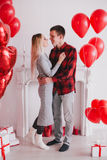 Happy young couple in love posing with red heart balloons Royalty Free Stock Photography