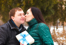 Happy young couple in love with present Stock Photography