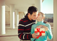 Happy young couple in love with present outdoors Royalty Free Stock Photos
