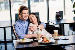 Happy young couple in love at romantic date in restaurant Stock Photo