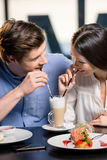 Happy young couple in love at romantic date in restaurant. Beautiful happy young couple in love at romantic date in restaurant Stock Image