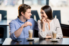 Happy young couple in love at romantic date in restaurant. Beautiful happy young couple in love at romantic date in restaurant stock images