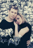 Happy young couple in love in spring garden Stock Photography