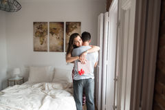 Happy young couple in love surprising each other with gifts Stock Images