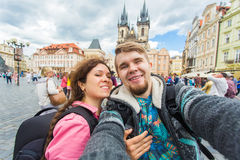 Happy young couple in love takes selfie portrait in Prague, Czech Republic. Pretty tourists make funny photos for travel Royalty Free Stock Photos