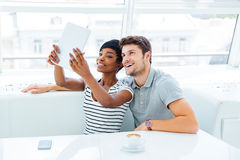 Happy young couple in love taking selfie with pc tablet Royalty Free Stock Photos
