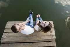 Happy young couple. Happy loving couple at the nature look at the camera Royalty Free Stock Image