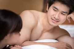A happy young couple lying on the bed Royalty Free Stock Photography