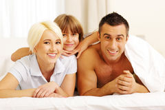 Happy young couple lying on the bed Royalty Free Stock Photo