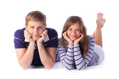 Happy young couple lying down on the floor Royalty Free Stock Image