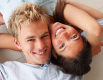 Happy young couple lying down together Royalty Free Stock Photos