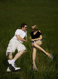 Happy Young Couple Lying in Grass on Sunny Day stock photos