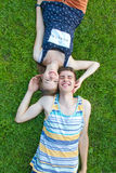 Happy, young couple lying in the sun Royalty Free Stock Photos