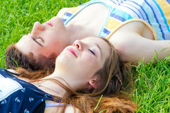 Happy, young couple lying in the sun Stock Photo
