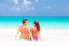 Happy young couple lying on a tropical beach in Cuba Royalty Free Stock Image