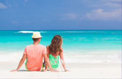 Happy young couple lying on a tropical beach in Cuba. Remote tropical beaches and countries. travel concept. Happy young couple lying on a tropical beach in Cuba Stock Photo