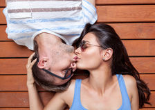 Happy young couple lying on a wooden floor Royalty Free Stock Photos