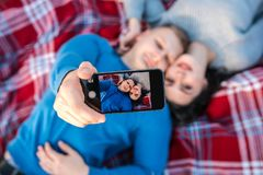 Happy young couple making selfie near sea. stock image