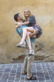 Happy young couple, man holding woman in his arms. Love. Stock Images