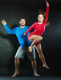 Happy young couple man and woman jumping for joy. Royalty Free Stock Photo
