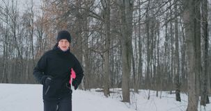 Happy young couple married sports morning and evening jogging in the park. stock video footage