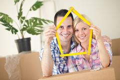 Happy young couple moving in new home Stock Photography