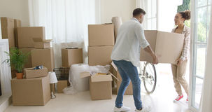 Happy young couple moving into a new house Royalty Free Stock Photo
