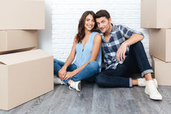 Happy young couple moving in new house Stock Photos