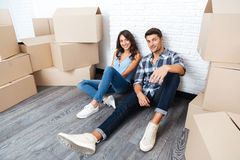 Happy young couple moving in new house. Happy young married couple moving in new house Royalty Free Stock Images