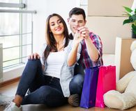 Happy young couple moving together in new apartment royalty free stock photos